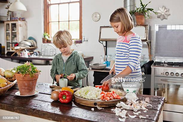 Children helping cook at home
