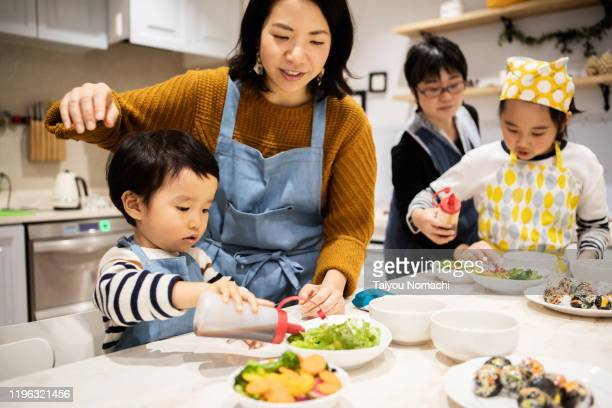 children helping to make salad - east asian ethnicity stock pictures, royalty-free photos & images
