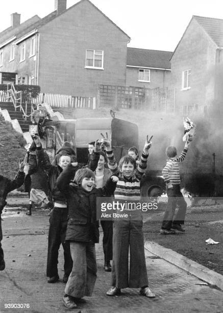 Children hijack vehicles to celebrate the shooting of a British soldier by an IRA sniper in West Belfast 12th April 1972