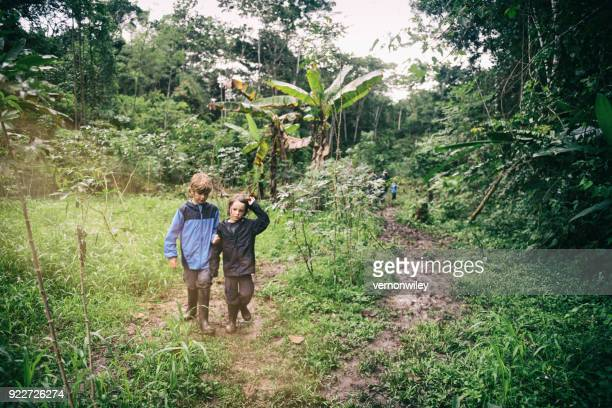 children hike and play in the jungle - south america stock pictures, royalty-free photos & images