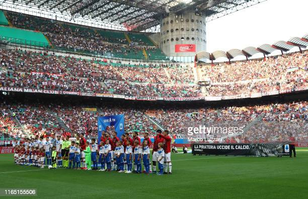 Children hold a banner with the inscription 'Piracy kills football' before the Serie A match between AC Milan and Brescia Calcio at Stadio Giuseppe...