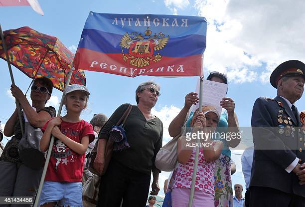 Children hold a flag of the socalled People's Republic of Lugansk during their rally in the eastern Ukrainian city of Lugansk on June 29 organized by...