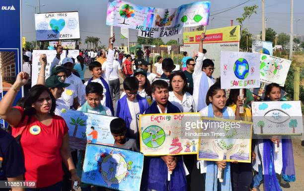 Children hold artworks ahead of Earth Day during Raahgiri Day an event organised by MCG and DLF at Sector 90 on April 21 2019 in Gurugram India...