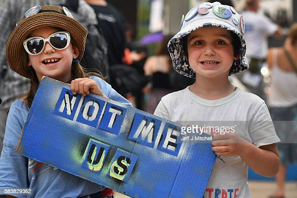 Children hold banners at a Bernie Sanders event near City Hall on day three of the Democratic National Convention on July 27 2016 in Philadelphia...