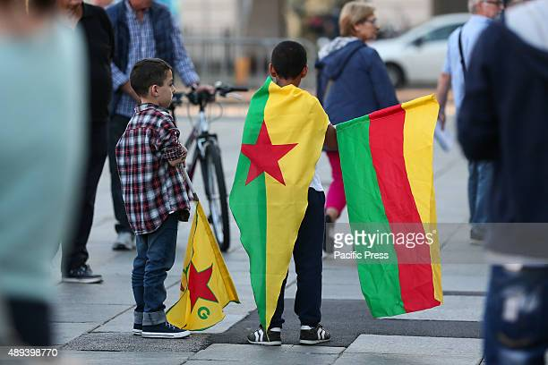 Children hold flags as they join other hundreds of people who protest against the attacks on the Kurdish people at the hands of Turkish President...
