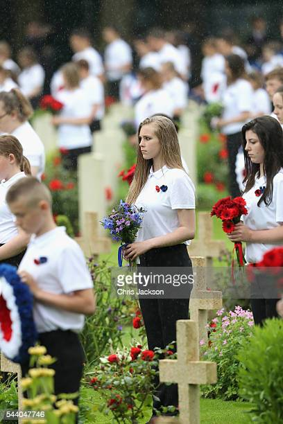 Children hold flowers as they take part in Somme Centenary Commemorations on July 1, 2016 in Thiepval, France. Today marks exactly 100 years since...