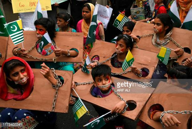 TOPSHOT Children hold Kashmiri and Pakistani flags as they take part in an antiIndian protest rally in Lahore on October 3 2019 The nucleararmed...