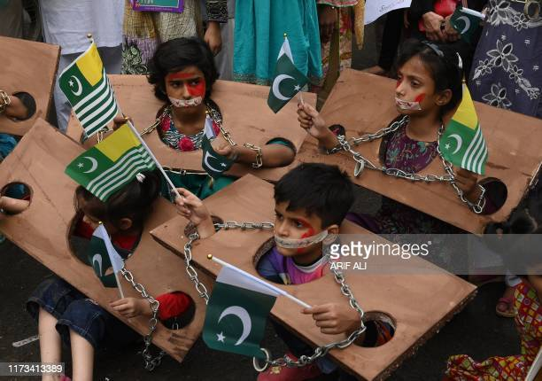 Children hold Kashmiri and Pakistani flags as they take part in an antiIndian protest rally in Lahore on October 3 2019 The nucleararmed neighbours...