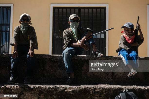 Children hold mock rifles during a Regional Coordinator of Community Authorities community police force gun training presentation held due to...