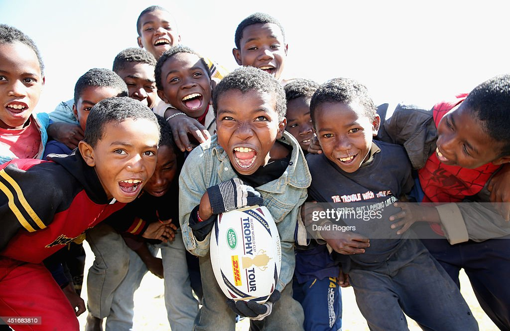 Children hold onto the ball during a visit to the Father Pedro Foundation during the Rugby World Cup Trophy Tour in Madagascar in partnership with Land Rover and DHL ahead of Rugby World Cup 2015 on July 4, 2014 in Antananarivo, Madagascar.