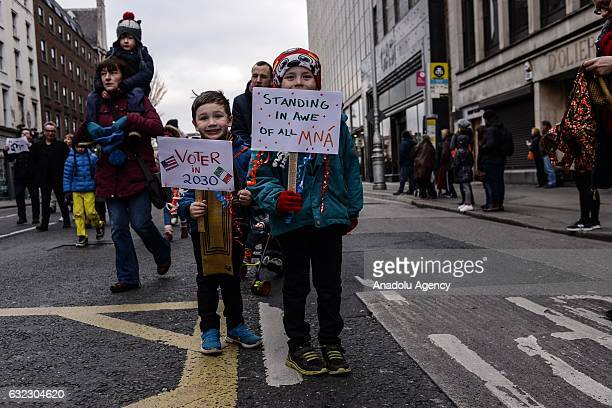 Children hold placards during a protest held in solidarity with the Washington DC Women's March in Dublin Ireland on January 21 2017