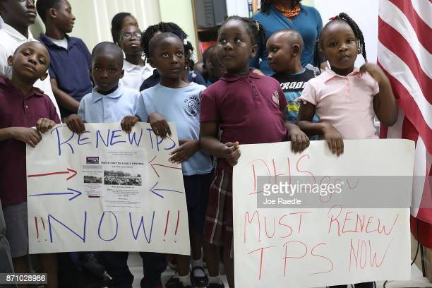 Children hold posters asking the Federal government to renew Temporary Protected Status during a press conference about TPS for people from Haiti...