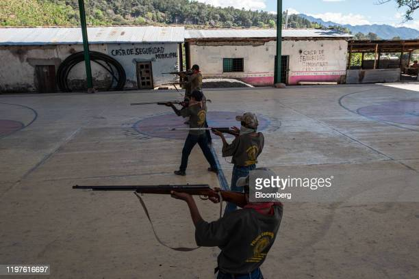 Children hold rifles during a Regional Coordinator of Community Authorities community police force gun training presentation held due to increased...