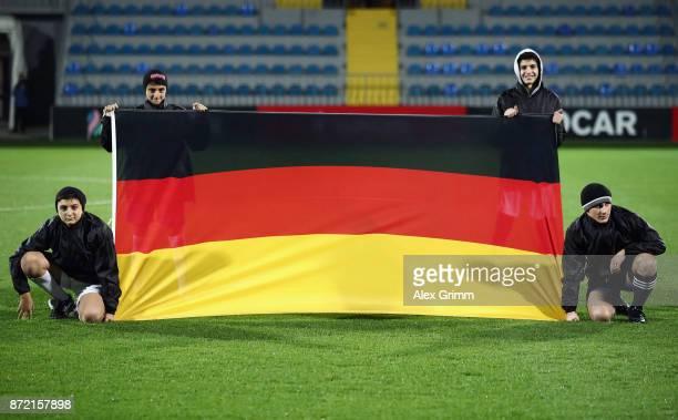 Children hold the German flag prior to the UEFA Under21 Euro 2019 Qualifier match between Azerbaijan U21 and Germany U21 at Dalga Arena on November 9...
