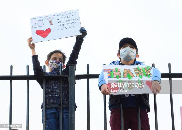 Children hold up thank you signs in Kips Bay during the coronavirus pandemic on May 4 2020 in New York City COVID19 has spread to most countries...