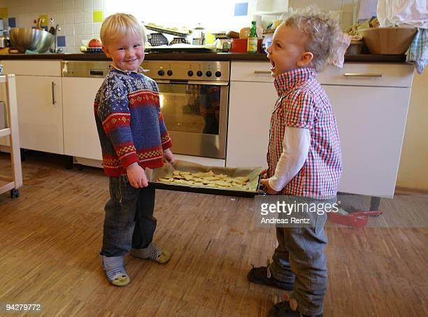 Children holding a tray of sugar cookies at a kindergarten of the Rudolf Steiner Waldorfschule on December 11 2009 in Berlin Germany Each year...