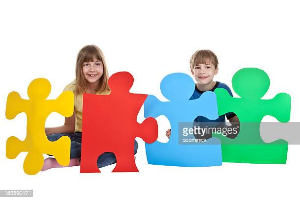 Children Holding Colorful Puzzle Pieces