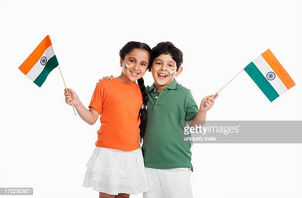 children holding indian flags - indian flag stock pictures, royalty-free photos & images