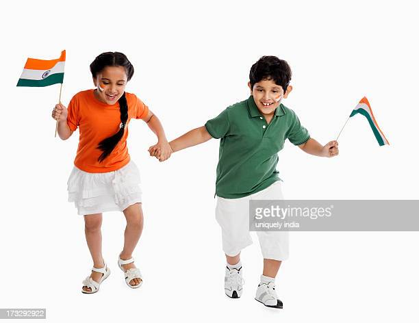 Children holding Indian flags