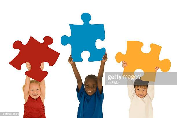 Children holding large jigsaw pieces