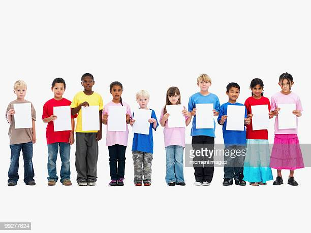children holding paper - person holding blank sign stock pictures, royalty-free photos & images