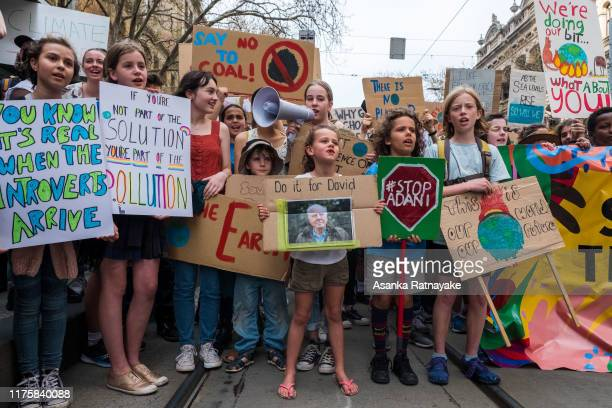 Children holding placards getting ready to march on September 20, 2019 in Melbourne, Australia. Rallies held across Australia are part of a global...
