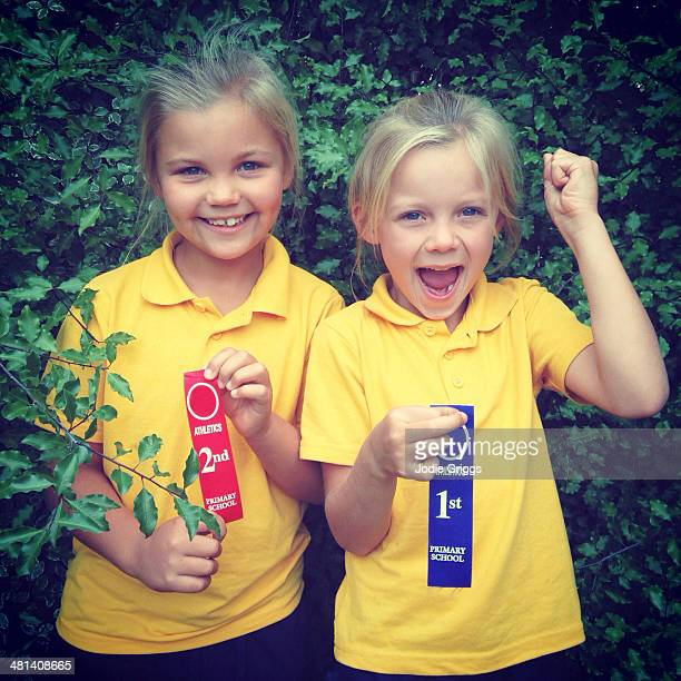 children holding place ribbons from athletics race - second place stock pictures, royalty-free photos & images
