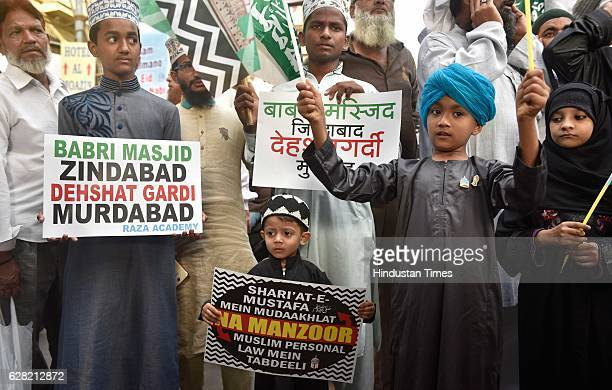 Children holding poster during the protest march to mark the 24th anniversary of the demolition of the Babri Masjid at Minara Masjid on December 6...