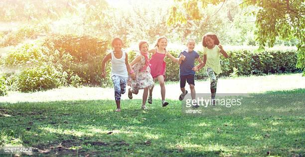 Children holding their hands and runnin