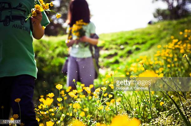 2 Children holding wildflower bouquets