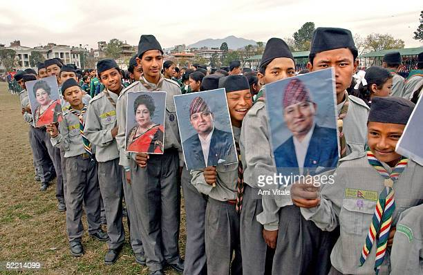 Children holds posters of King Gyanendra and Queen Komal as thousands of people arrive to celebrate Democracy Day and to greet the Queen Komal who...