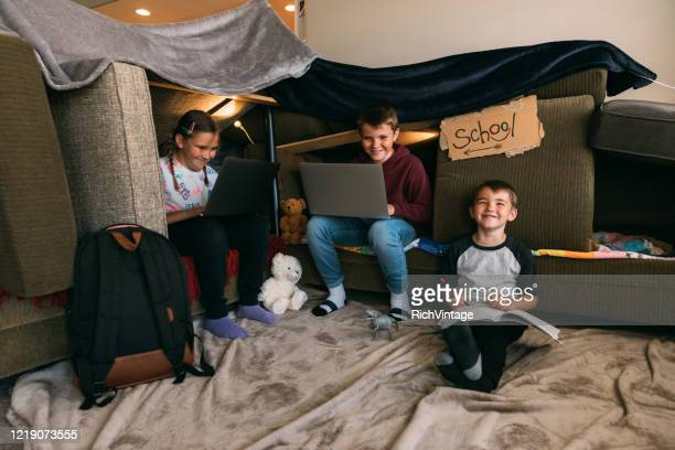 children homeschooling in a couch fort - homeschool stock pictures, royalty-free photos & images