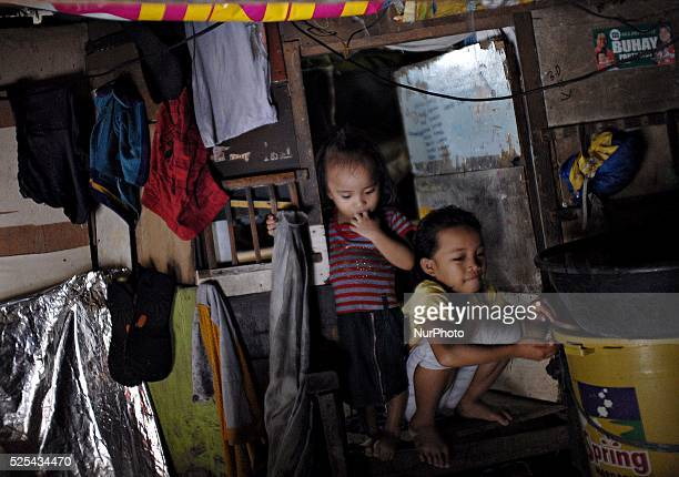 Children idle inside their makeshift home under a busy bridge in Quezon city suburban Manila Philippines July 30 2013 Photo Ezra Acayan/NurPhoto