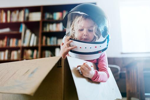Children Imagine Space Adventure in Cardboard Box - gettyimageskorea