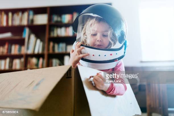 children imagine space adventure in cardboard box - imagination stock pictures, royalty-free photos & images