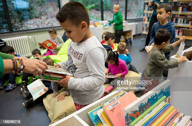 Children in a children´s libary during the presentation of Project 'Lesestart' on November 15 2013 in Berlin Germany The Project offers book packages...