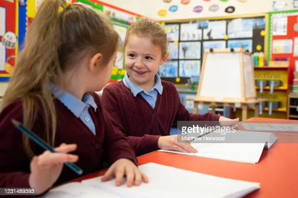 Children in a classroom at Glan-Yr-Afon primary school on March 3, 2021 in Cardiff, Wales. Children aged three to seven began a phased return to...