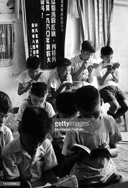 Children in a commune reading books supplied by the library Beijing 1961