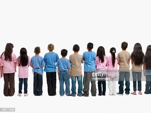 children in a line - length stock pictures, royalty-free photos & images