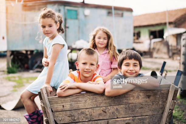 children in a poor residental area - orphan stock pictures, royalty-free photos & images