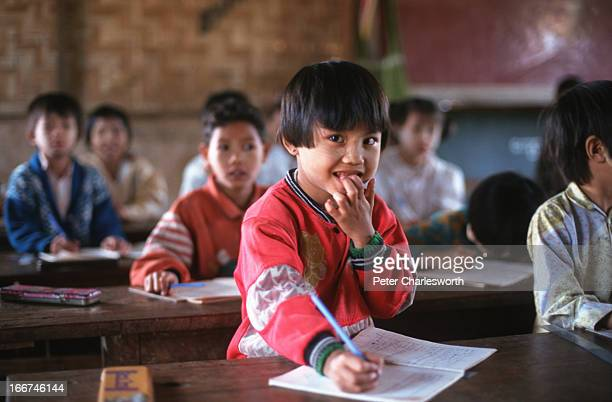 Children in a tiny village attend their oneroom primary school The per capita expenditure on education in Burma is about 72 cents per year the per...