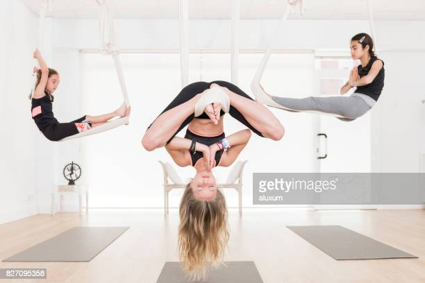Children in aerial yoga class