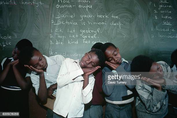 Children in an elementary school in Crossroads the largest squatter camp in South Africa near Cape Town play a game of 'Simon Says'