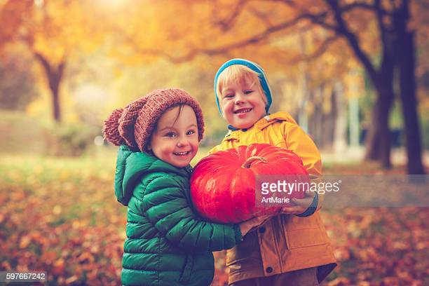 children in autumn park at halloween - halloween kids stock photos and pictures