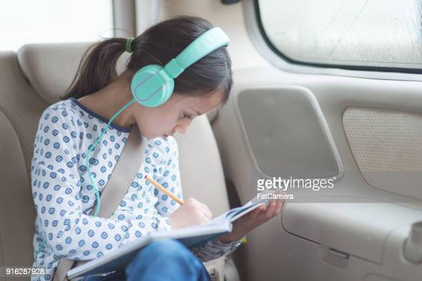 Children in Back Seat on Road Trip