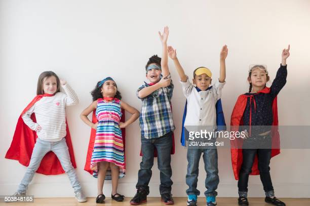 children in capes - multiculturalism stock pictures, royalty-free photos & images
