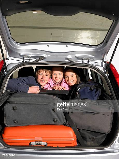 Children in car with luggage