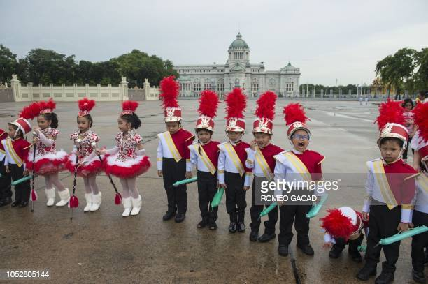TOPSHOT Children in colorful uniforms gather for a memorial ceremony for late King Chulalongkorn at Royal Plaza in Bangkok on October 23 2018 The...