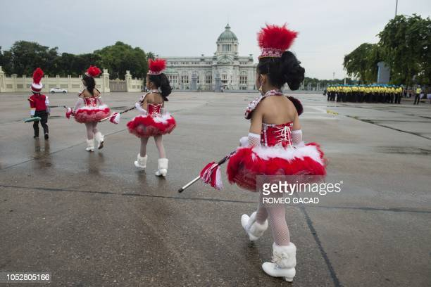 Children in colorful uniforms gather for a memorial ceremony for late King Chulalongkorn at Royal Plaza in Bangkok on October 23 2018 The national...
