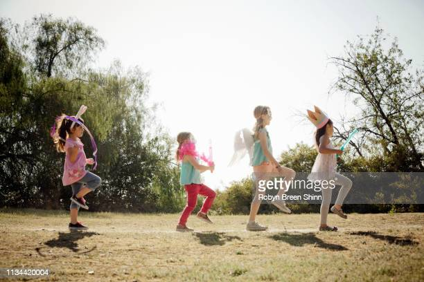 children in costume marching - marching stock pictures, royalty-free photos & images